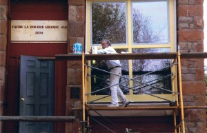 Craig Brodahl, the Bellvue Grange Grand Master, works on a window at the grange. All of the restoration work is being done by volunteers.  Photo by Judy Jackson