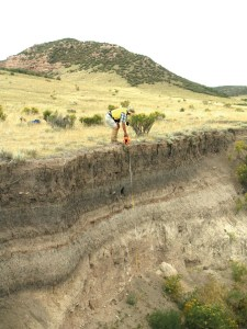 Measuring the depth to the Lindenmeier level in 2013. Photo by Gary Raham