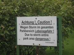 Storm warning sign in park