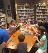 Volunteer working with a group of kids at the library
