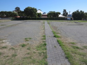 Photo of the empty space before the garden.