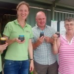 Photo of members with plum jam made from plums from the garden.