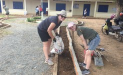 Community service group pouring concrete
