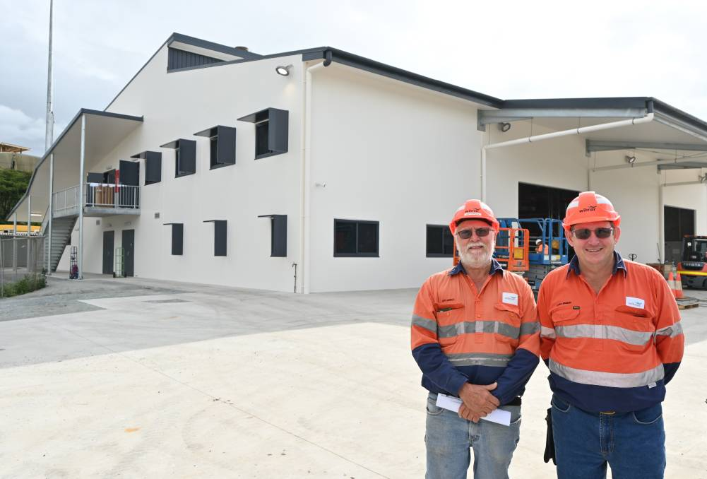 Vesuvian contractor Jeff Arnold, and Wilmar reliability engineer, Laurie Johnson, outside Proserpine Mills new store building.