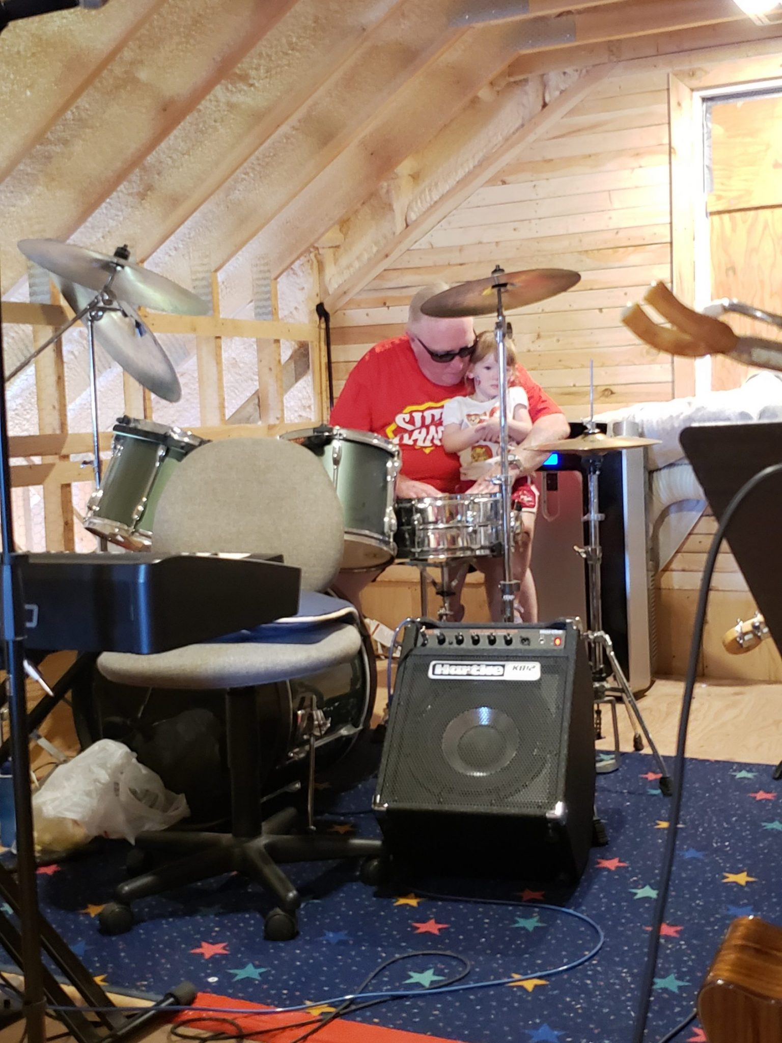 Grampa plays drums with me.