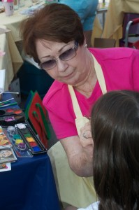 NTCR volunteer Sue concentrating on one of her many face painting masterpieces.