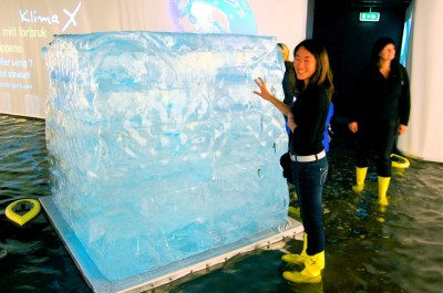 Two enormous melting ice cubes symbolise the melting of the Arctic ice cap.  On the wall next to one of the ice cubes is an animation showing the melting of the Arctic summer sea ice.  The visitors can see that the North Pole might become free of ice by the year 2050.