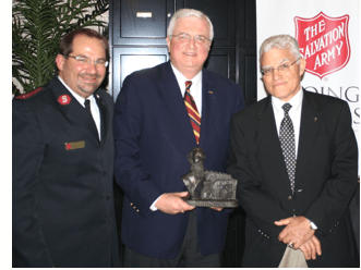 From Left to Right:  Captain Ken Argot, Van D. Hipp, Jr., and Vince Lombardi, Jr. at the Annual Salvation Army Dinner in Alexandria, Virginia.