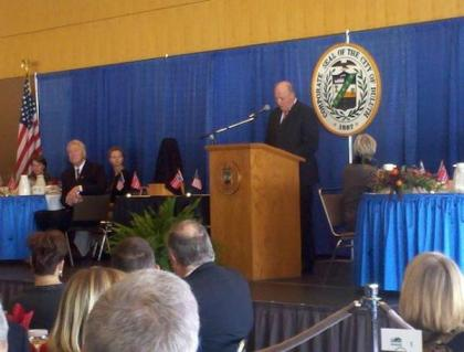King Harald speaks at a luncheon in Duluth.