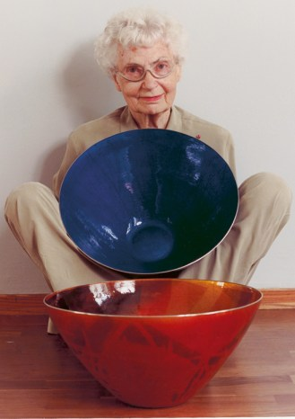 Grete Kittelsen with two of her enameled bowls.