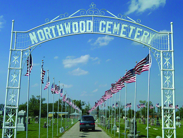 Photo: Larrie Wanberg  Northwood Cemetery festooned with flags.