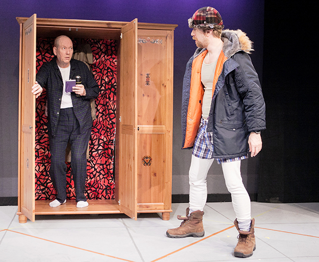 Photo: C. Stanley Photography Agoraphobic Elling hiding in the wardrobe and Kjell Bjarne, who abhors trousers, coaxing him out.