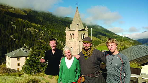 Photo courtesy of Øystein Rivrud  The pilgrims with Barbara, in whose house they slept over in Bourg St. Pierre. The old churchtower rises in the background.