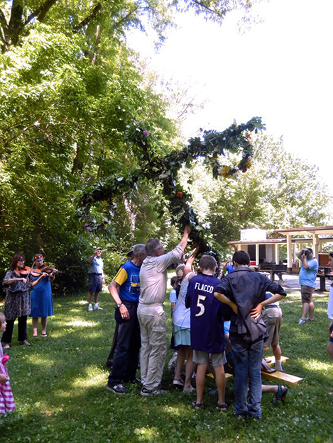 Photo: Marshall H. Cohen, A.S.A.  The raising of the decorated maypole.