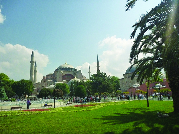 """Photo: Carla Danziger Aya Sofya (also known as Hagia Sophia), one of the world's most iconic buildings, has been an Istanbul (formerly Constantinople) landmark for almost 1500 years. Consecrated as an Eastern (Greek) Orthodox cathedral (""""Church of the Divine Wisdom"""") in 537, Aya Sofya received Christian worshippers and visitors for the next 816 years until the Ottoman Turks conquered Constantinople in 1453. Admiring the beautiful church, the Ottoman sultan ordered it to be converted to a mosque. Christian mosaics were removed or plastered over, and Islamic features added, including four minarets. For the next 482 years, the mosque welcomed Moslem worshippers."""