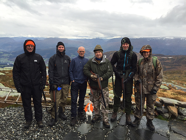 Photo: Nils Wanberg Grins are the norm in this hunting party, despite grim weather.