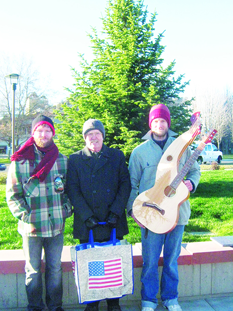 Photo: Barbara K. Rostad Tony Powell, left, and Dave Powell, right, with Freedom Harp Guitar, flank Lt. Col. Fred McMurray, Ret. in front of Coeur d' Alene's recently dedicated new Freedom Tree honoring not only Fred McMurray but all veterans, especially POWs and MIAs.