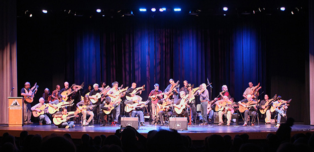 Photo: Gregg Miner The Grand Finale of the Saturday night concert at this year's Harp Guitar Gathering, with all the concert artists on stage.