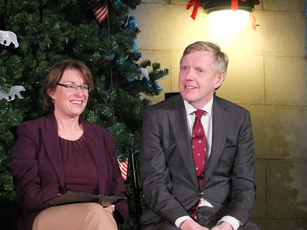 Photo: Bruce Guthrie Minnesota Senator Amy Klobuchar and Ambassador Aas sit in front of the impressive tree.