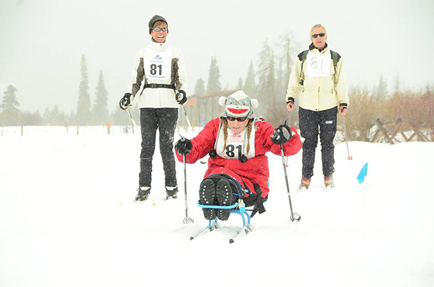 Photos: Ski for Light / Facebook In Ski for Light, skiers with visual or mobility impairments are paired with guides, and big smiles result.