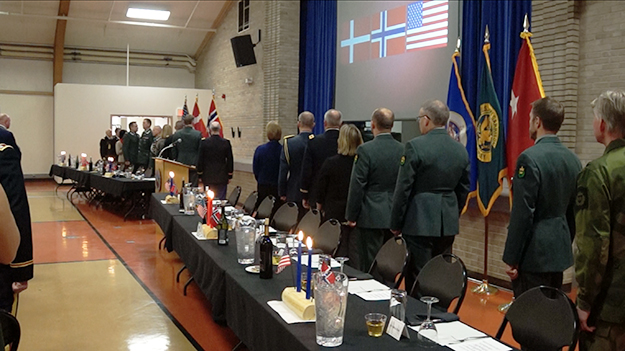 Photo: Aaron Hagström Dignitaries from both countries stand for national anthems.