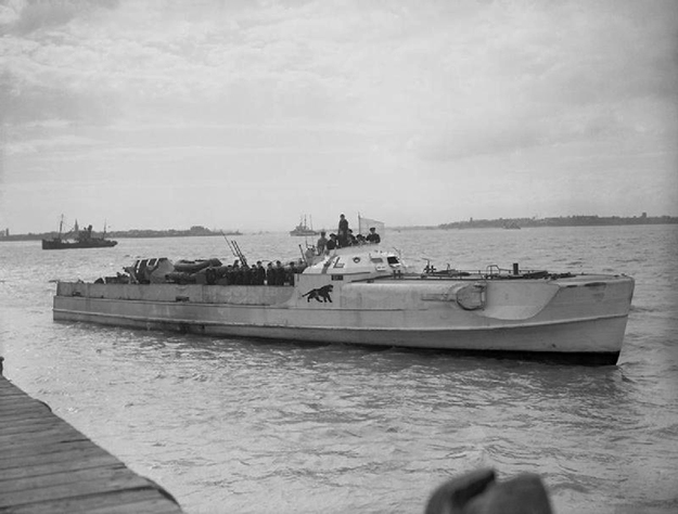 "Photo: Wikimedia Commons The German Schnellboot (""E-boat"") S 204 flying a white flag of surrender at the coastal forces base HMS Beehive, Felixstowe, Suffolk (UK), on May 13, 1945."