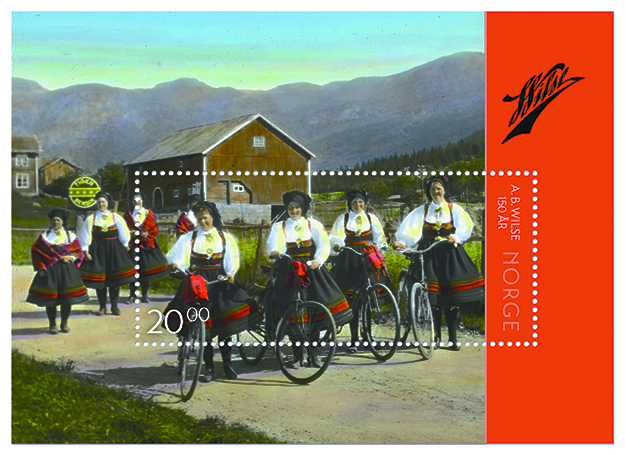 """Photo courtesy of Posten Norge The stamps use images of Wilse's famous photographs. This 20 kroner stamp is taken from """"Setesdal, på vei til kirken,"""" a 1934 hand-colored photograph."""
