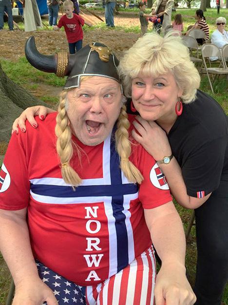"Photo: Arlene Bakke Rutuelo / Facebook ""Crazy Bob"" and Arlene Bakke Rutuelo share a moment at Viking Fest this Syttende Mai."