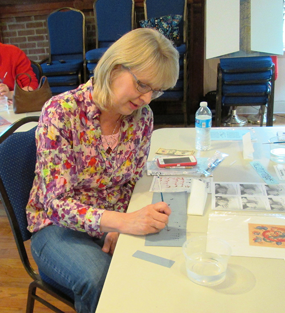 Photo: Christine Foster Meloni Denise taps into the genetic talent that allows any Norwegian to learn rosemaling.