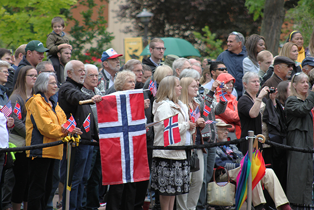 Photo: Emily C. Skaftun, Norwegian Americans gathered early at PLU's Red Square to watch folk dancing and singing and await the king.