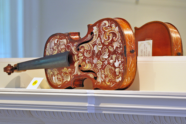 Photo: Kathi Santora / The Writing Studio The gallery space at the Liridodendron Mansion is perfect for showcasing objects in situ, like this beautifully rosemaled violin.