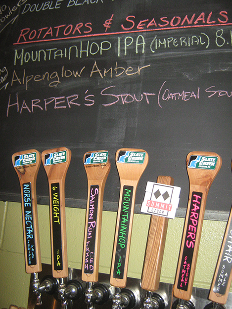 Photo: Barbara K. Rostad These beer taps at Slate Creek are made of tops of canoe paddles. The lower parts of the paddles are used as sampler trays for Slate Creek brews.