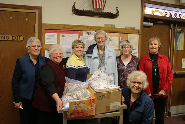 Photo: Solveig Lee Stamp cutters, from left to right: Barbara Engbrecht, Marilyn Tangen, Marit Hagen, Solveig Lee, Alice Sorensen, Kathryn Ulland. Front: Sigi Bell.