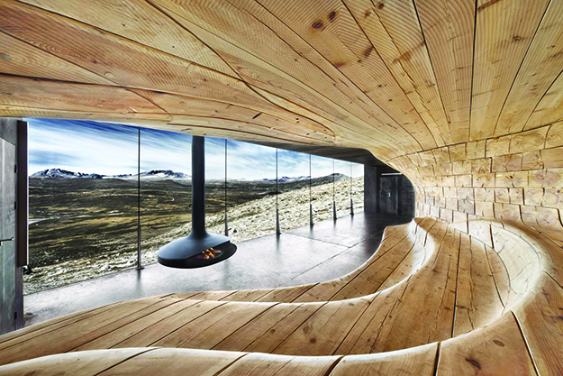 Photo: diephotodesigner.de OHG / Snøhetta, Snøhetta's design uses natural materials and soft shapes to make a cozy place to gather and watch wildlife.