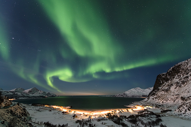 Photo: Fredrik Broms The little village of Grøtfjord in Northern Norway looks out to the open sea with a spectacular view of the northern skies.