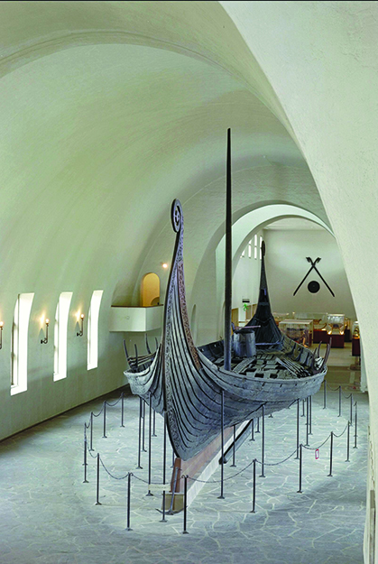 Photo: Erik Irgens Johnsen / Museum of Cultural History, Oslo The Oseberg ship on display in the Viking Ship Museum in Oslo.