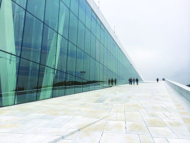 Photo: David Nikel Weather doesn't always cooperate with the goal of great photographs. The cloudy day makes Oslo's incredible Opera House look somewhat dreary.