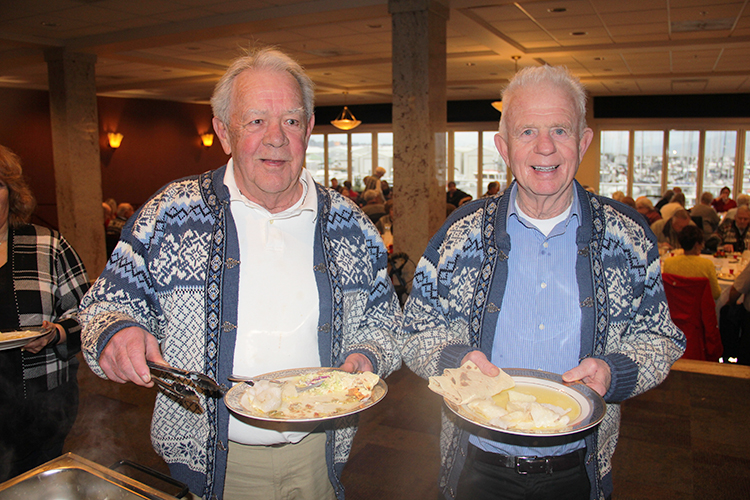 Photo: Solveig Lee Jack Larson and Albert Larwen enjoy lutefisk and lefse in their matching Norwegian sweaters.