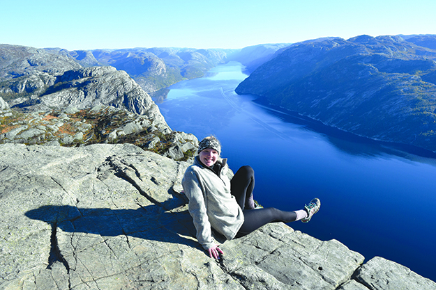Photo courtesy of Laura Aanonsen Visiting high places seems to be a theme of the folkehøgskole experience. Aanonsen at the famous preikestolen (preacher's pulpit).
