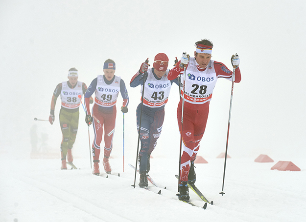 "Photo: Fischer / NordicFocus / Faster Skier  Canadian Devon Kershaw leads American Noah Hoffman, Norway's Vebjørn Turtveit and, Germany's Thomas Wick during the men's 50 k classic mass start Holmenkollen race on February 6 in Oslo, Norway. The race is ""a battle from the start,"" according to Kershaw."