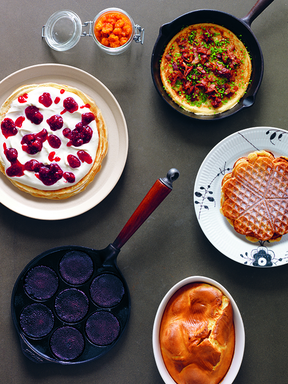 Photo: Erik Olsson / courtesy of Phaidon Grains and Cereals. Clockwise from top left: Sugared Cloudberries, Norwegian Thick Salt-Pork Pancakes, Waffles, Thick Oven-baked Pancake, Blood Pancakes, and Pancake Torte. From The Nordic Cookbook, Magnus Nilsson, £29.95 / $49.95 US / €39.95 / $59.95 CAN / $59.95 AUS Phaidon 2015, www.phaidon.com.