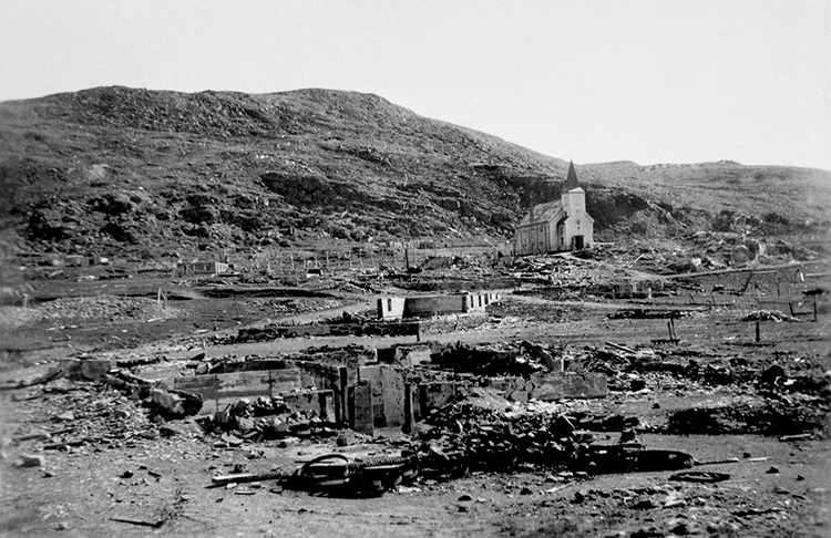 Photo courtesy of Nordkappmuseet in Honningsvag. The white wooden church in Honningsvag was the only building to survive the scorched earth burning of the town. Today it's a symbol of the total destruction of northern Norway during the war.