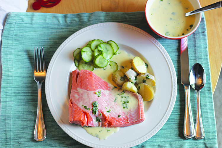 Photo: Christy Olsen Field Once you try this poached salmon with Sandefjordsmør, you'll want to eat it all summer long.