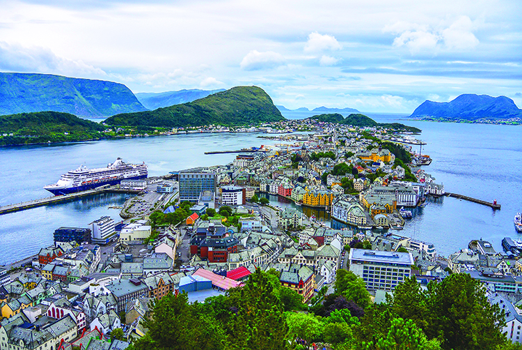 Photo: Elisabeth Beyer Ålesund from above. The trail up Mount Aksla is well maintained, and this view is the reward.
