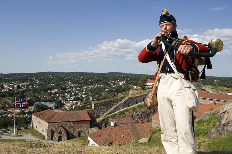 Photo: Terje Rakke / Nordic Life AS /  Visitnorway.com A reenactor at the Fredriksten Fortress makes history come alive.