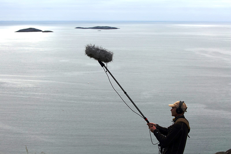 Photo: Krista Caballero,  Frank Ekeberg in the field, collecting sounds for his Birding the Future exhibit.