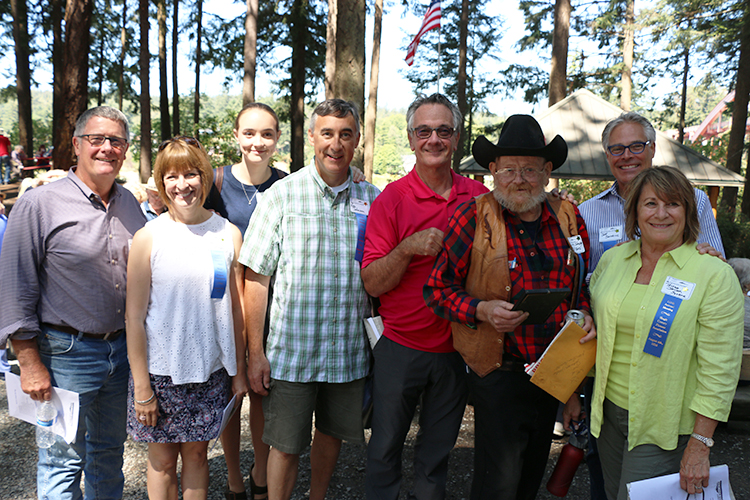 Photo: Solveig Lee Members of the Johnson family with spokesman Larry in the hat.