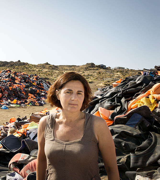 Photo: © UNHCR / Gordon Welters Efi Latsoudi, one of the winners of UNHCR's Nansen Award 2016, stands amid a vast mountain of life preservers, a haunting reminder of the dangers faced by refugees.