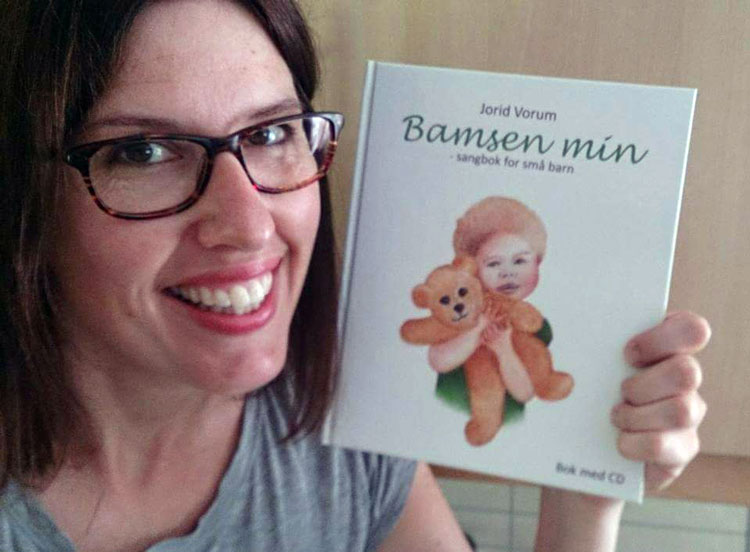 Jorid Vorum, composer and author, with her new book of songs. Photo: Frittspillerom / Facebook