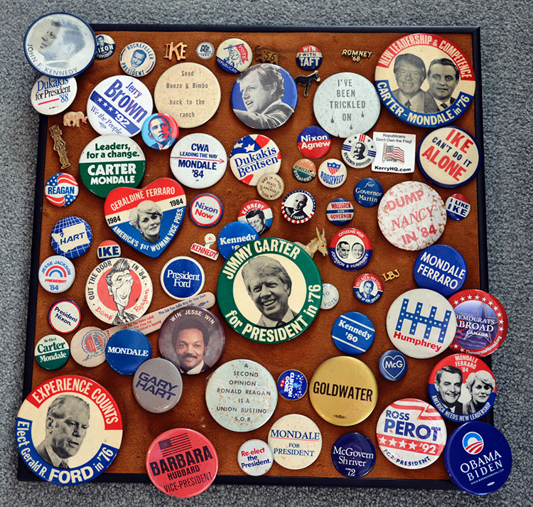 """Photo: Scott Larsen Scott's presidential button collection, started when he was a teenager. The oldest one is a 1916 Woodrow Wilson button (not shown) that reads: """"War in Europe, Peace in America, God bless Wilson."""""""